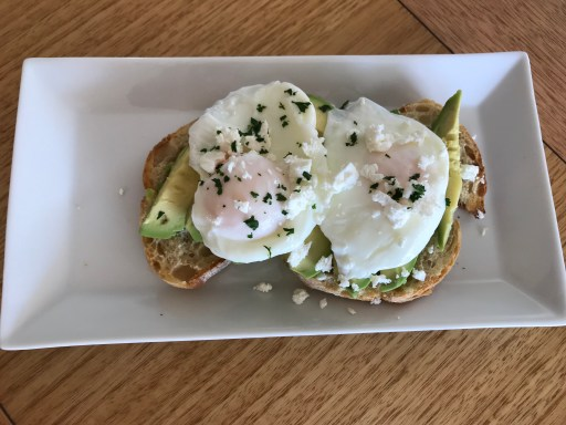 Smashed avo with poached eggs and feta cheese