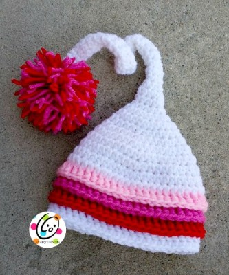 Add appliques without sewing a button to the hat.