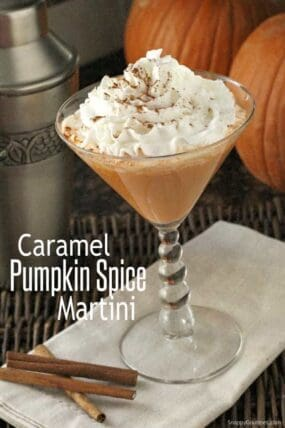 Caramel Pumpkin Spice Martini in martini glass with whipped cream