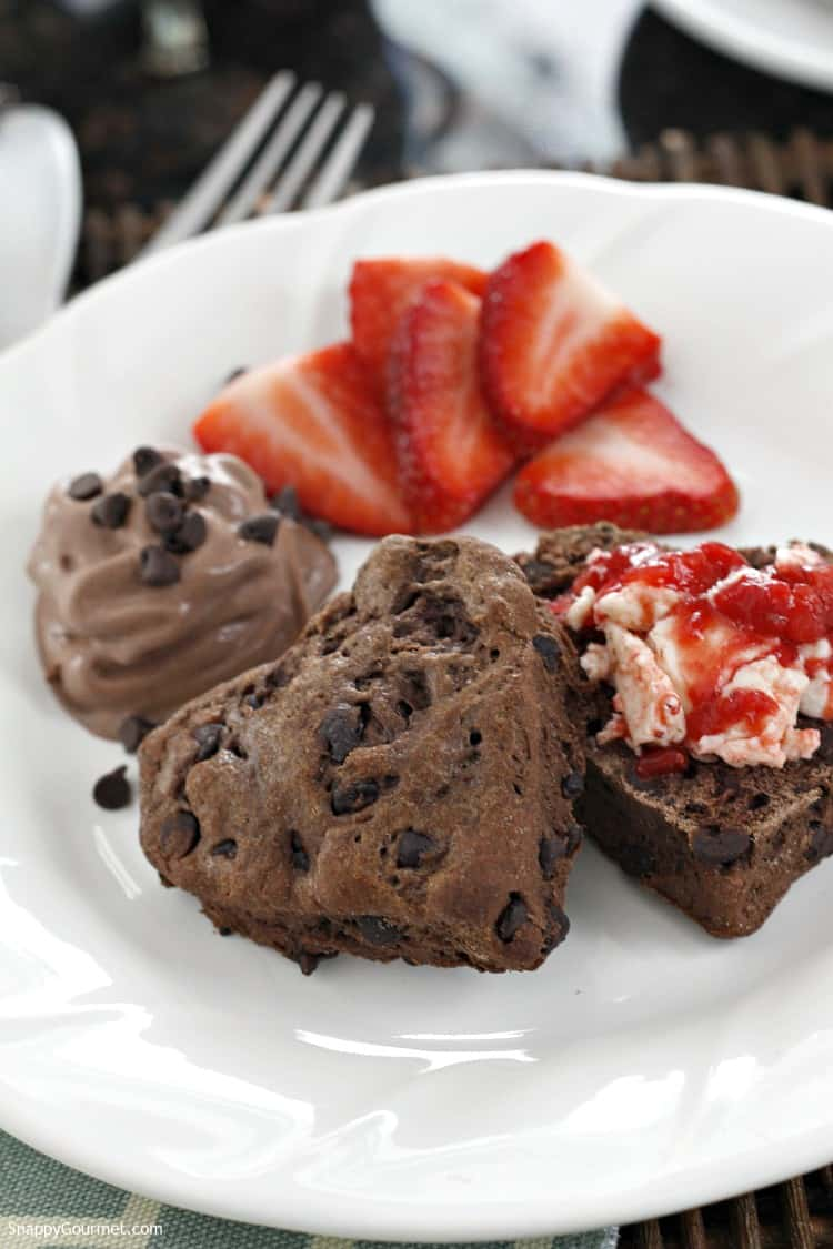 Chocolate Chocolate Chip Biscuits with Strawberry Butter and fresh strawberries on plate