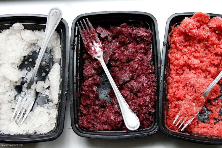 red, white, and blue granita in different containers with forks