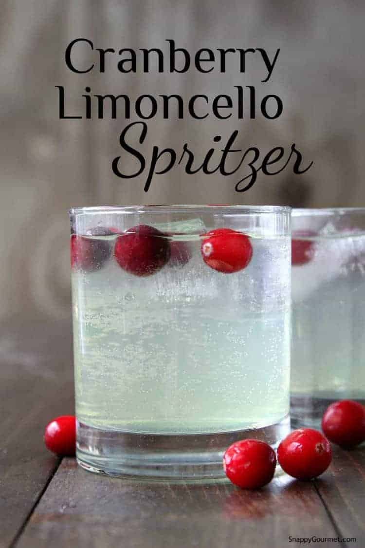 limoncello drink in glass with frozen cranberries