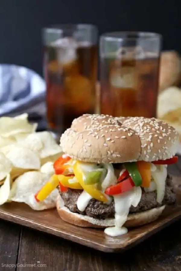 Philly Cheesesteak Burger - easy beef burger recipes topped with a quick cheese sauce and lots of onions and bell peppers | SnappyGourmet.com