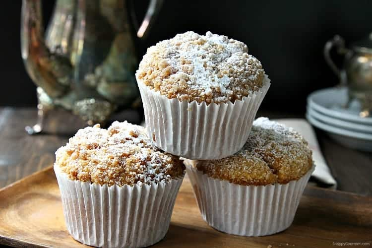 pumpkin muffins in white paper liners stacked on tray