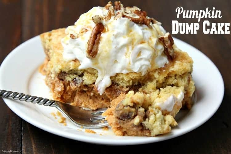 Pumpkin Dump Cake with whipped cream, caramel, and nuts
