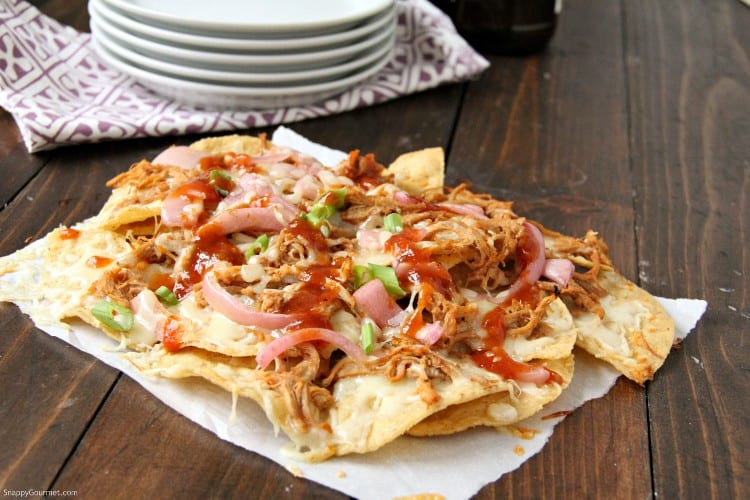 BBQ Nachos baked in oven on table with pork and onions