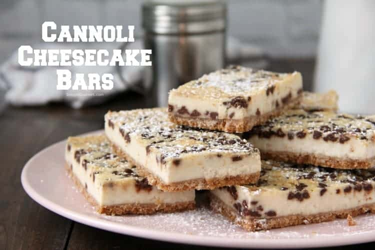 Cannoli Cheesecake Bars stacked on plate