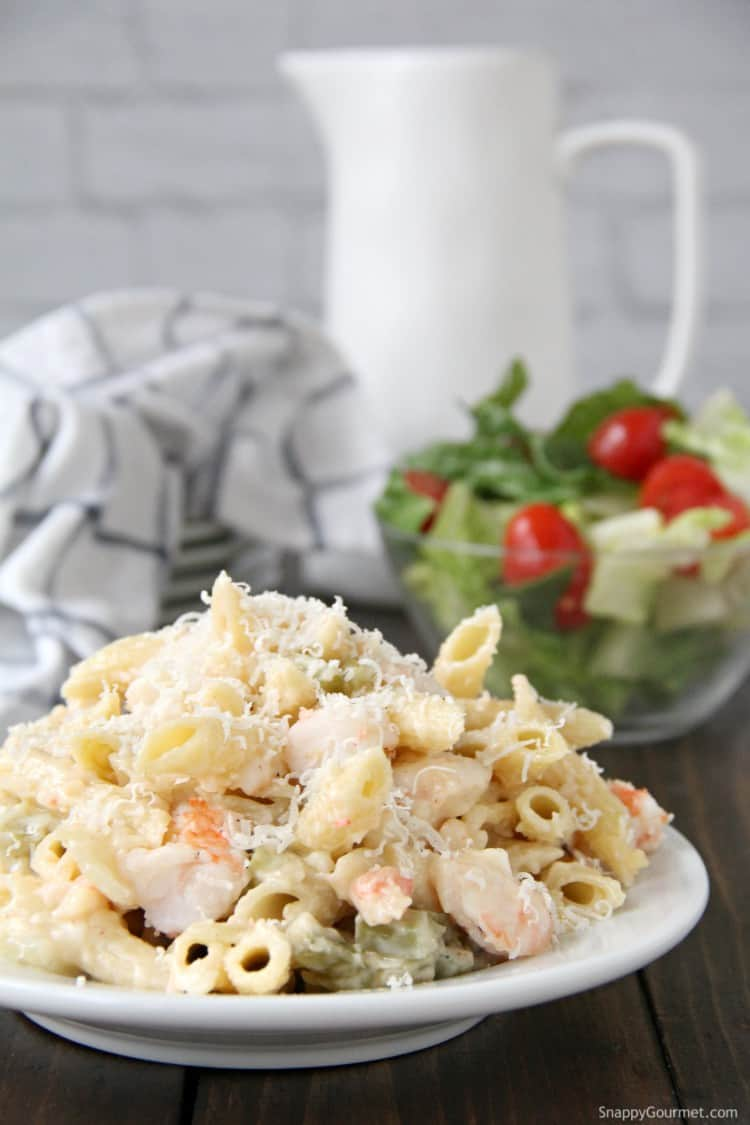 Cajun Shrimp Alfredo pasta on plate with salad