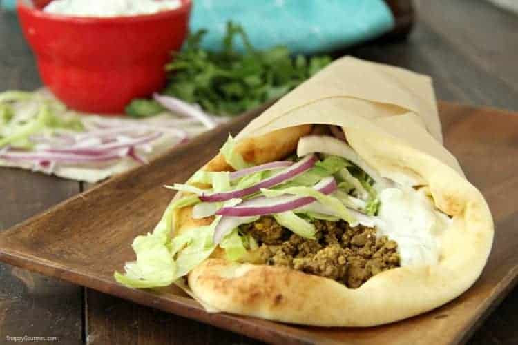Curry Lamb Naan Sandwich wrapped in parchment paper