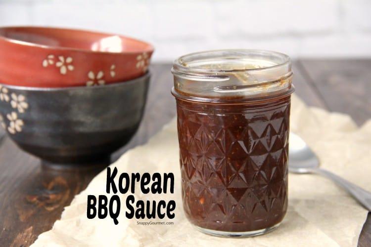 Korean BBQ Sauce in mason jar next to bowls