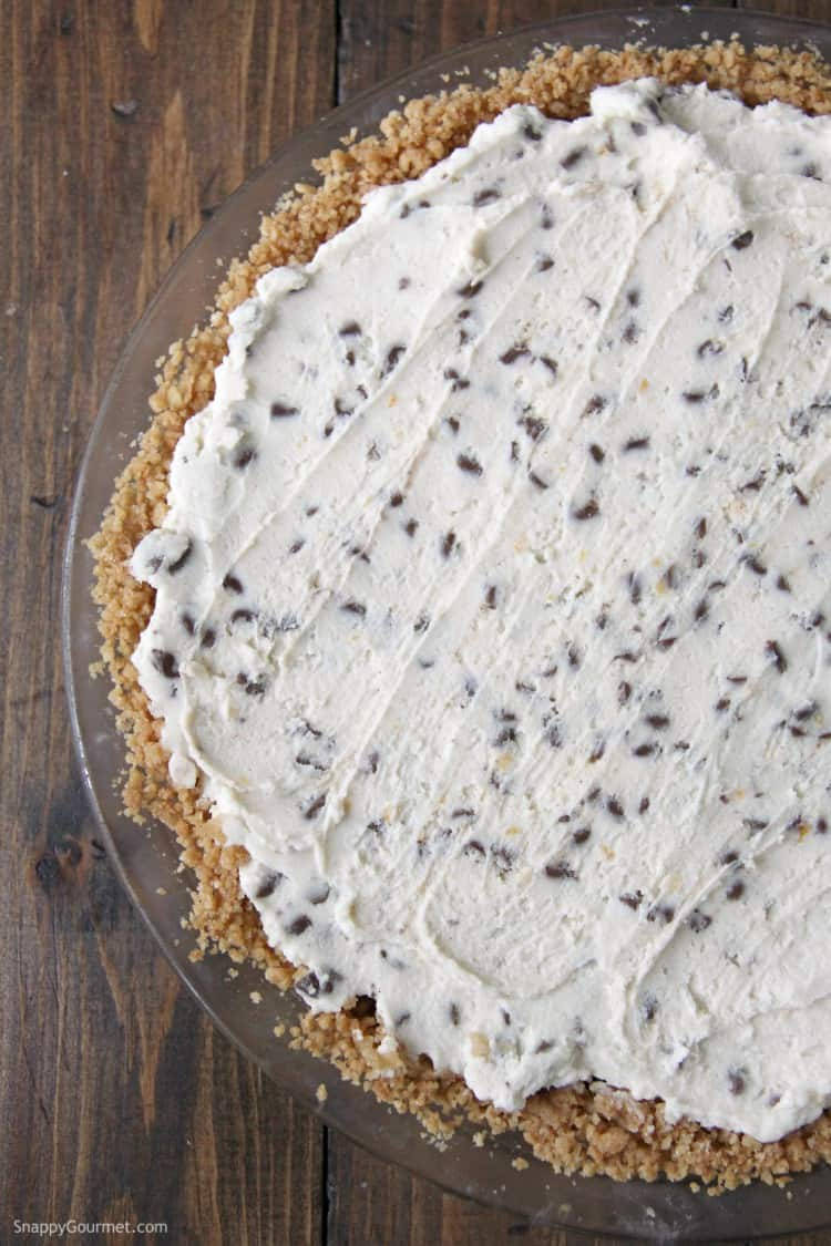 homemade cannoli pie crust filled with cannoli cream with chocolate chips