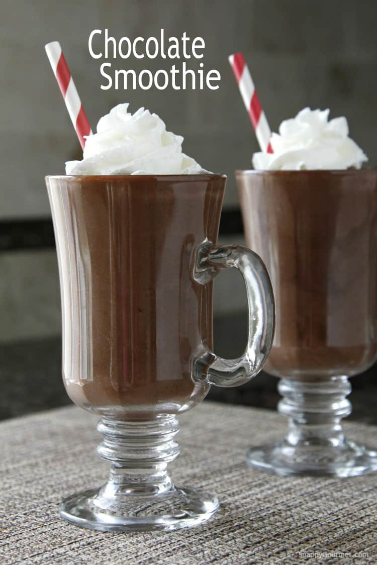 Chocolate smoothie in glass with whipped cream