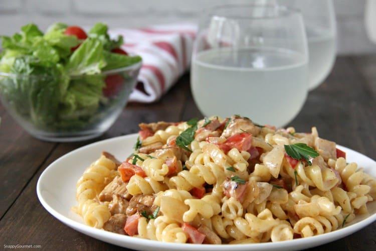 Cajun Chicken Alfredo pasta with salad and drink