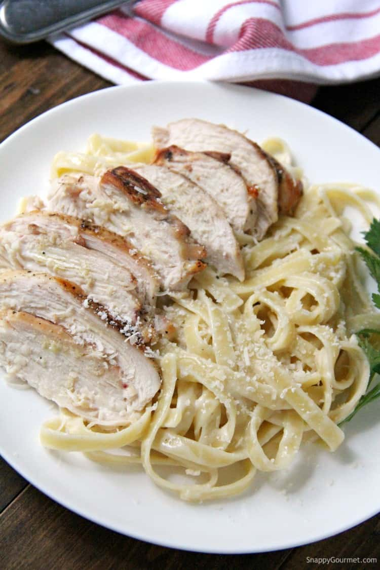 Grilled Chicken Alfredo Pasta with homemade alfredo sauce on plate