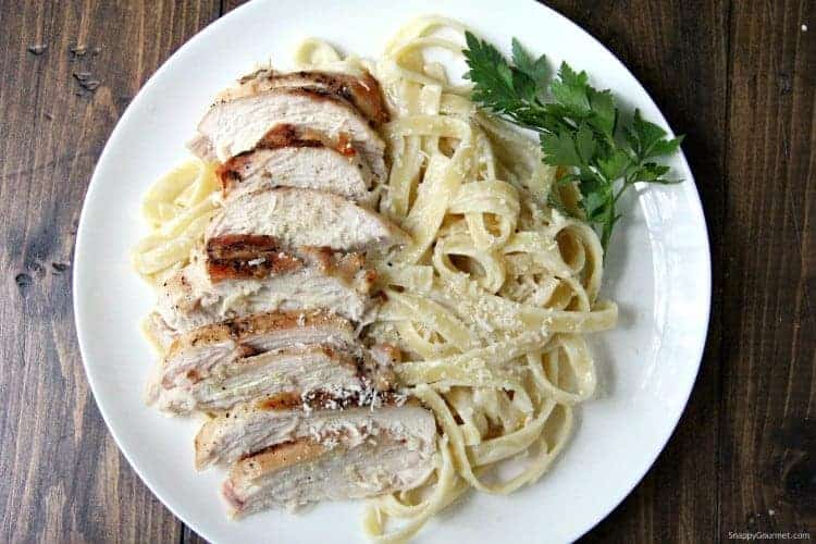 Grilled Chicken Alfredo with fettuccine on plate