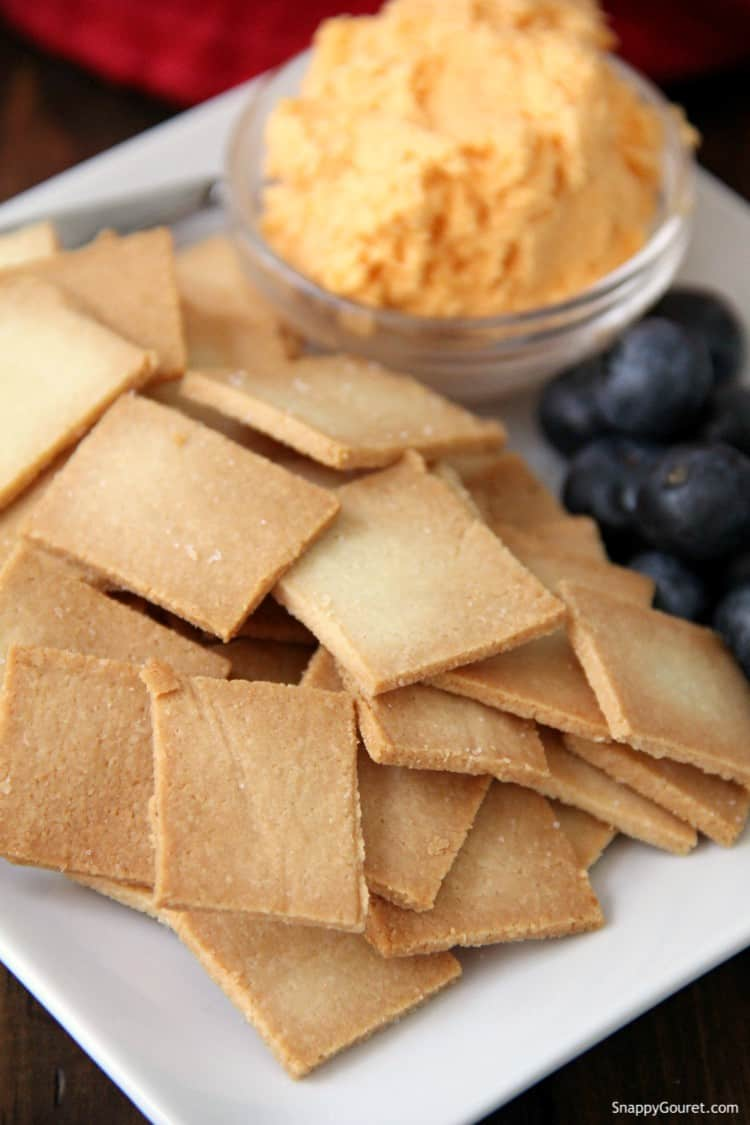Almond Flour Crackers on white plate with berries and cheese