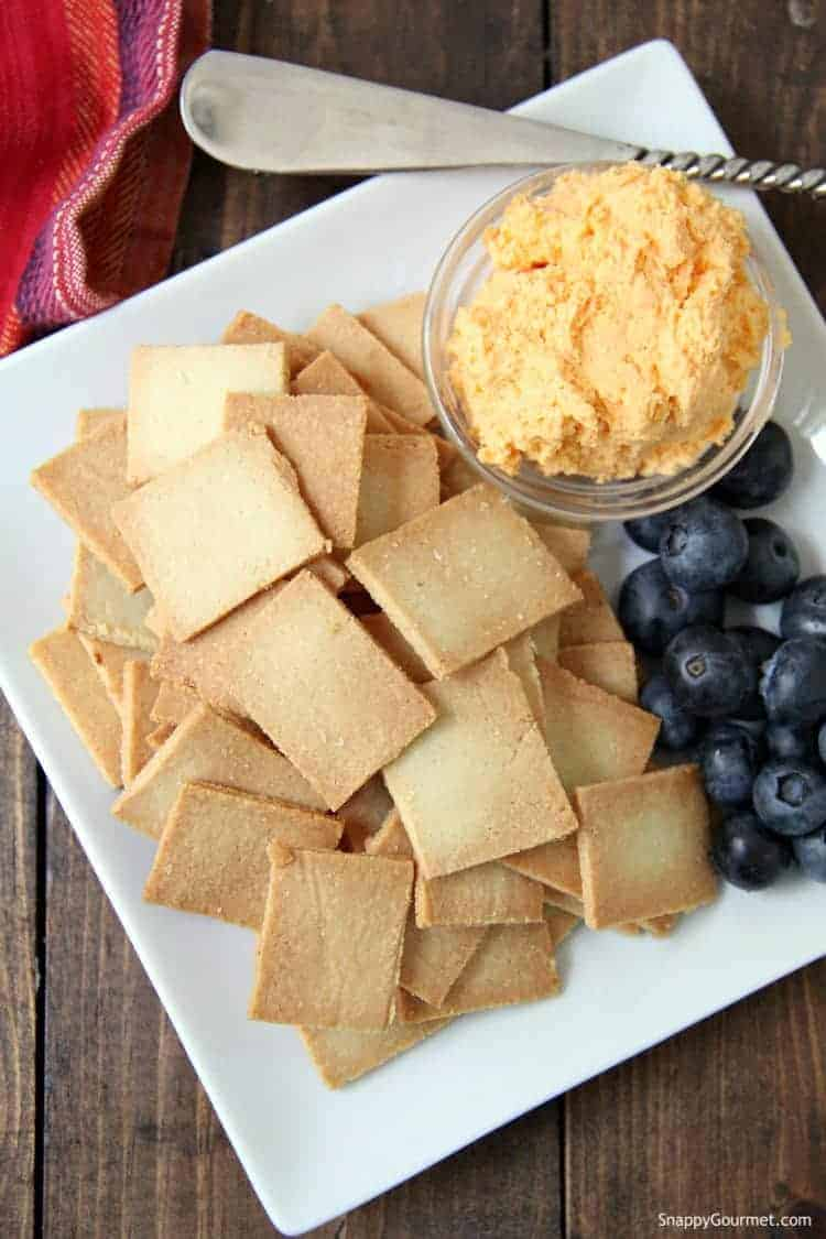Almond Flour Crackers on white plate with cheese and berries