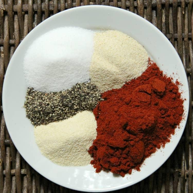 ingredients for burger seasoning on plate
