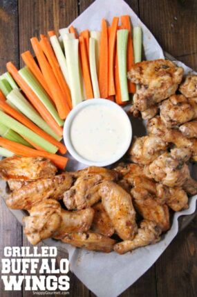 grilled buffalo wings with carrots and celery