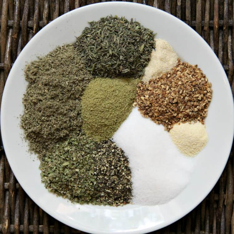 ingredients for poultry seasoning on plate