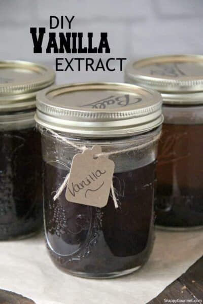 homemade vanilla extract in mason jar with string and gift tag