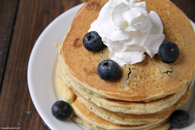almond flour blueberry pancakes on plate with blueberries