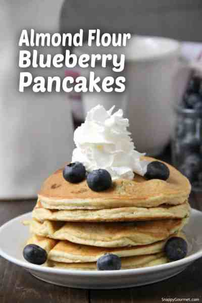 stack of blueberry pancakes on plate