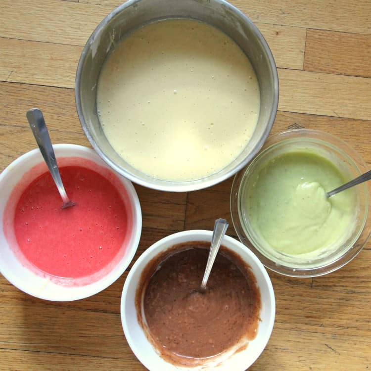 pistachio, chocolate, and cherry cake batter in bowls