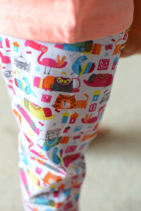 close up of brightly coloured patterned leggings