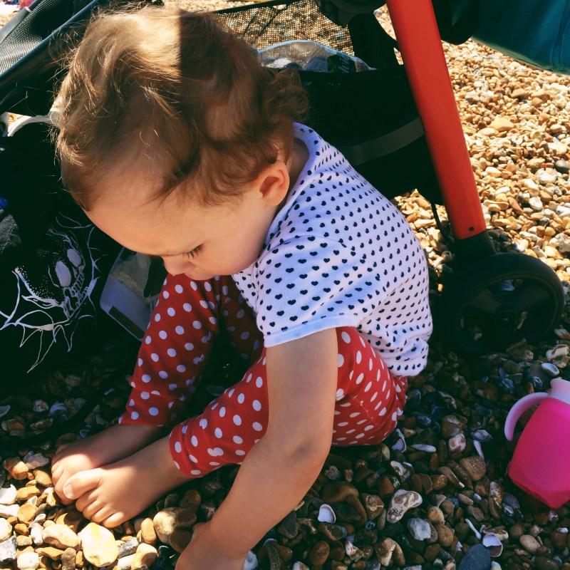 toddler girl on brighton beach