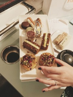 platter of food with hand taking a cake