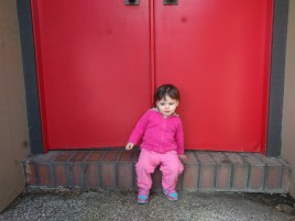 sitting_red_door