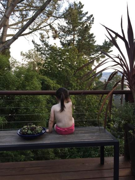 sitting_on_deck_back