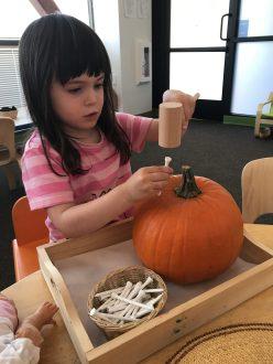 halloween_pumpkin_carving_hammering