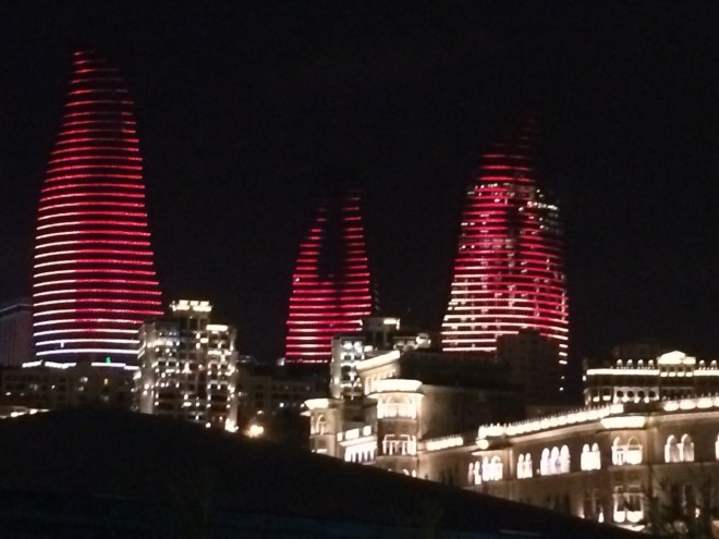 Flame Towers lit up at night