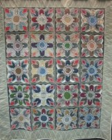 1870s embroidered tied quilt