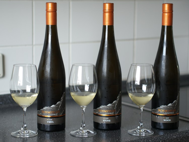 Front view of the three bottlings: Steel, Stone and Wood, with glasses