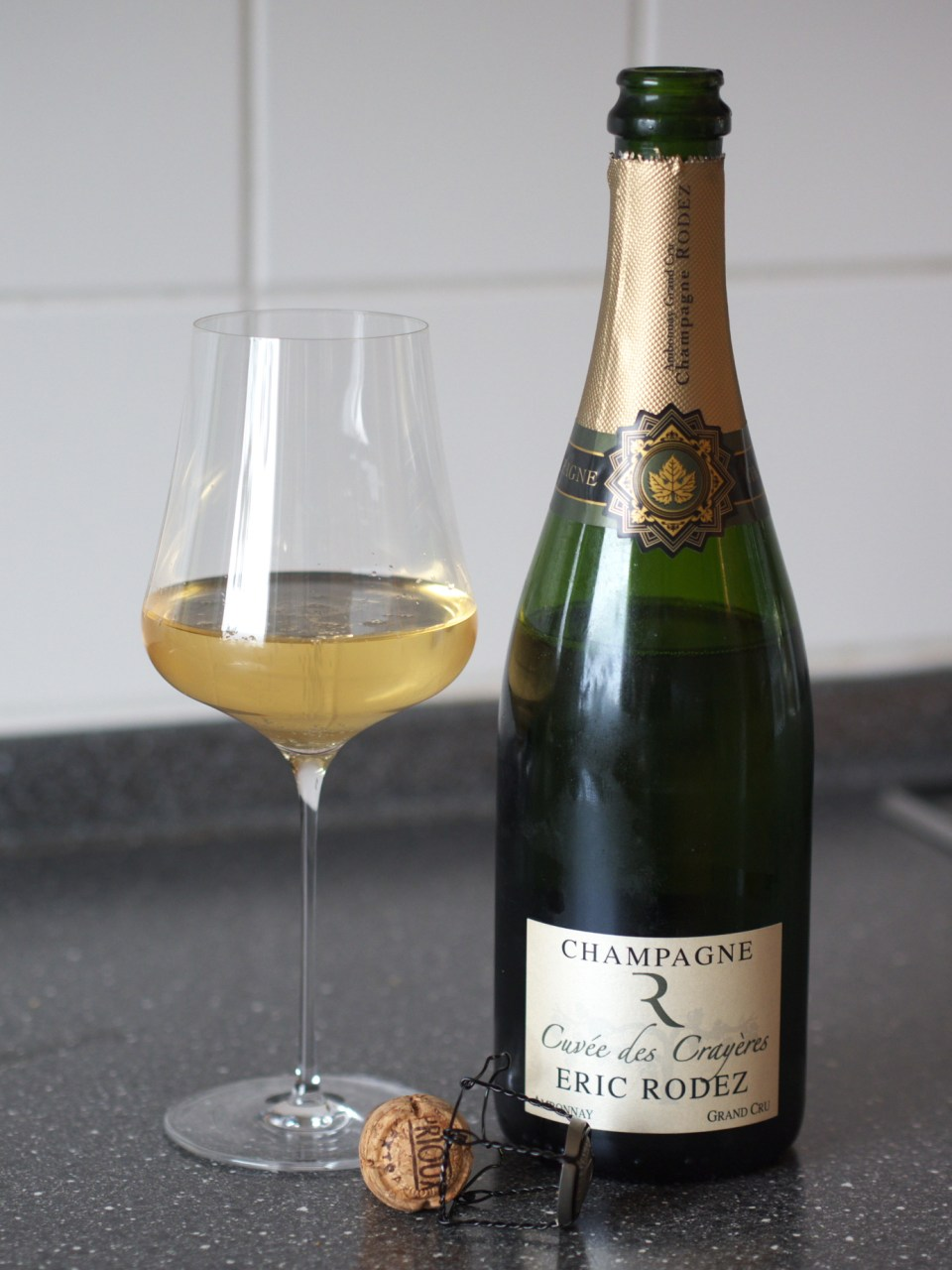 A glass and cottle of Cuvée des Crayères Champagne from Eric Rodez