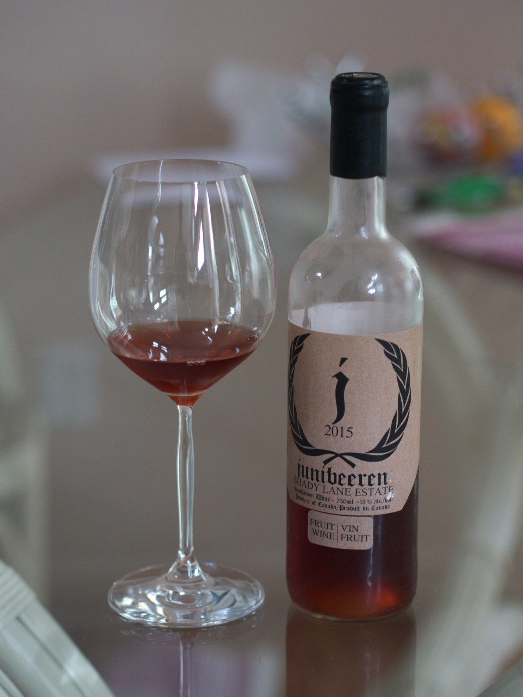A bottle and glass of Saskatoon wine from Shady Lane Estate Winery