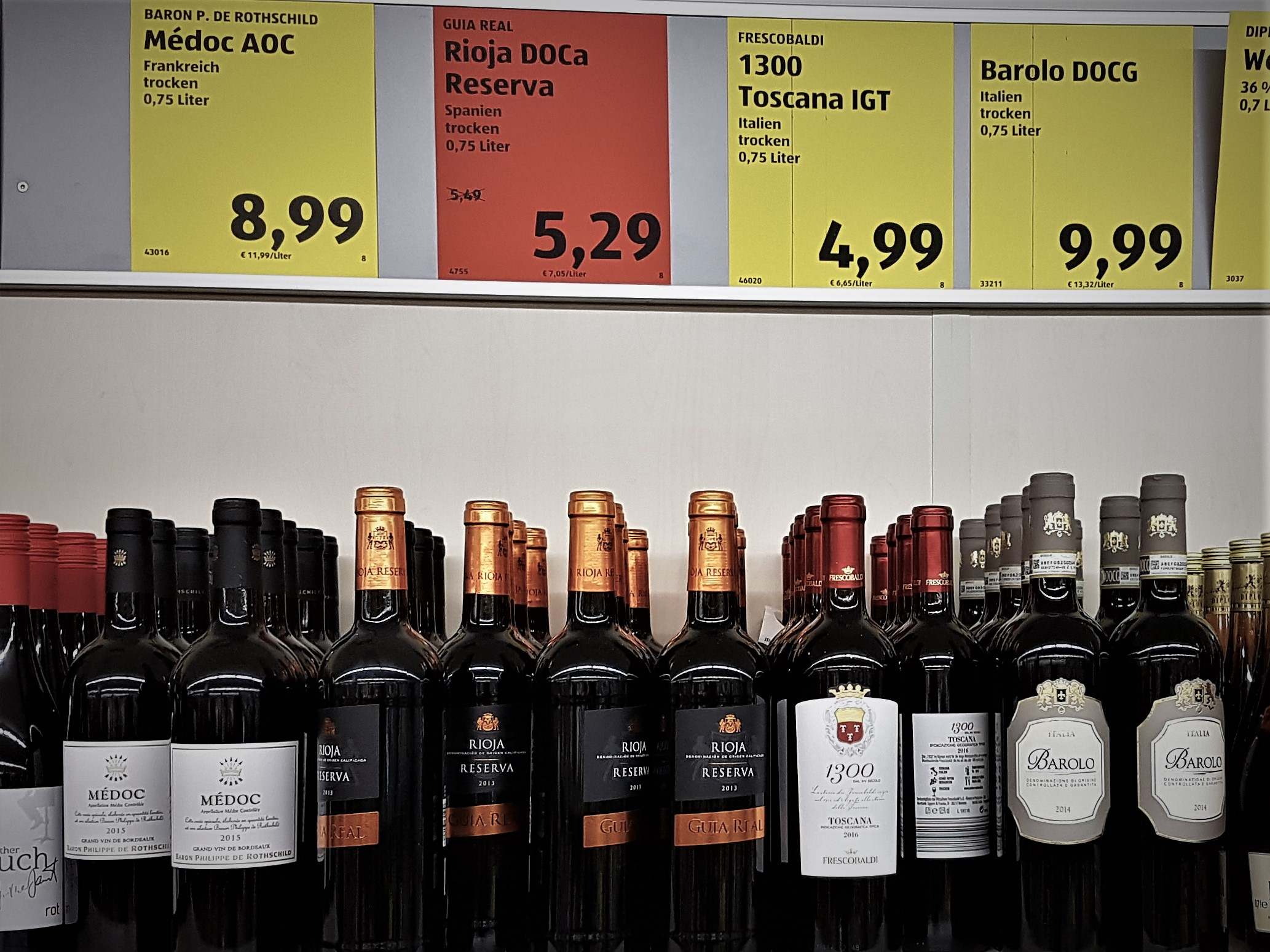 Shelf of wine bottles at Aldi.