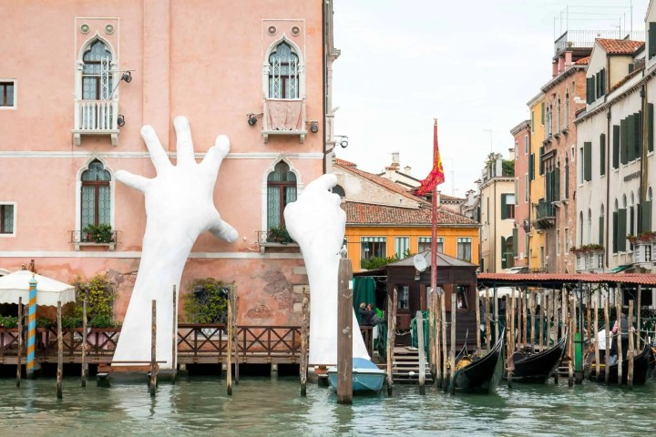 large white hands on building in the Venice Lagoon