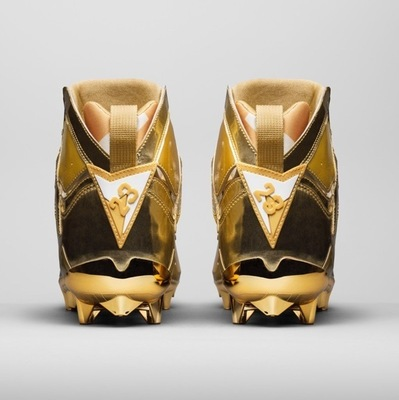 charles-woodson-gold-air-jordan-7-cleats-5.jpg