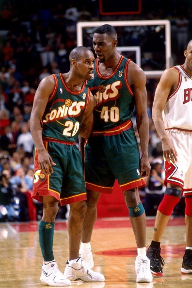 Gary Payton wearing the Nike Air Thrill Flight & Shawn Kemp wearing the Reebok Optix Image via Getty