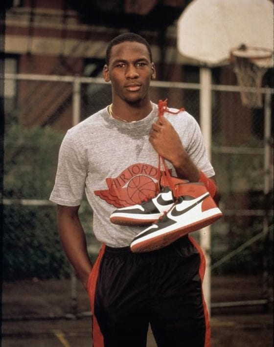 Michael Jordan wearing the Wings Jordan logo shirt.