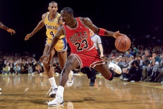 Michael Jordan wearing the Air Jordan III against Byron Scott of the Lakers