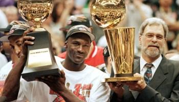 Michael Jordan, Phil Jackson holding Trophys