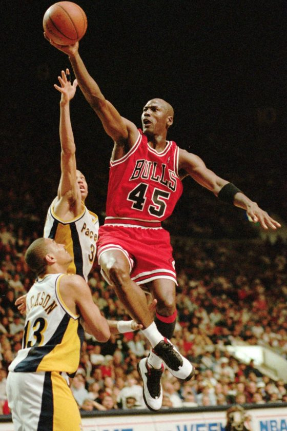 "Chicago Bulls guard Michael Jordan flies to the hoop over the Indiana Pacers' Reggie Miller and Mark Jackson (13), March 19, 1995, in Indianapolis, Ind. Nicknamed ""Air Jordan"" for his superb athleticism, he was named the National Basketball Association's Most Valuable Player in 1988, 1991, 1992, 1996 and 1997. He also holds the NBA highest scoring title. Jordan retired from basketball on Jan. 13, 1999, after leading the Bulls to six championships. Among the world's most admired sportsmen, Jordan has starred in movies and TV commercials, and endorses numerous products from basketball shoes to breakfast cereals. (AP Photo/Michael Conroy)"