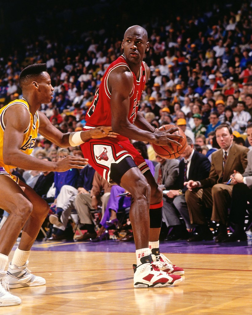 Michael Jordan wearing the Air Jordan 6 Carmine - Chicago Bulls Sneakers