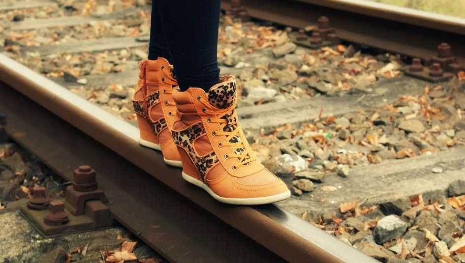 shoes made of leather standing on tracks