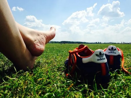 arch of feet with soccer cleats